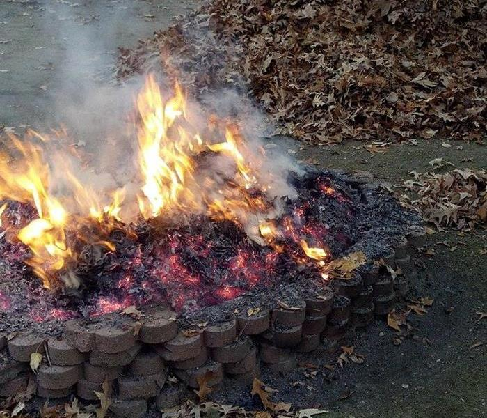 fire pit near pile of leaves