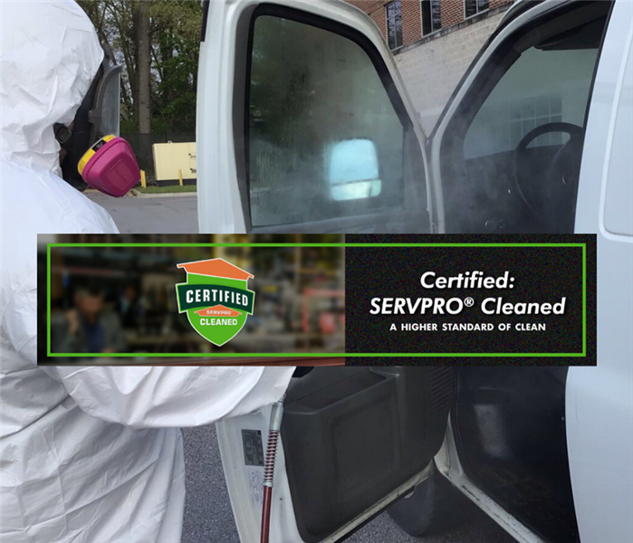 Man wearing PPE fogging a van with EPA-hospital grade disinfectant
